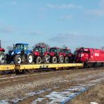 Photographer: Christopher Locke  Photo Taken: Racine, WI  Photo of: Canadian Pacific 4611 with New Case Tractors